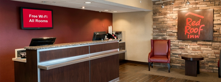 red roof inn chicago downers grove - lobby and front desk carousel.jpg